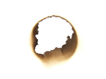 Burned paper hole Royalty Free Stock Images