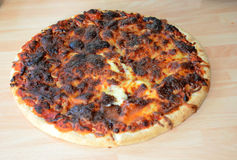 Burned pizza. Bad cooking, burned pizza cheese royalty free stock images