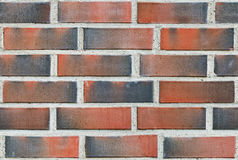 Burned red lining brick wall Stock Photo