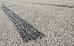 Burned rubber tire track on an asphalt road. Close up Stock Photo