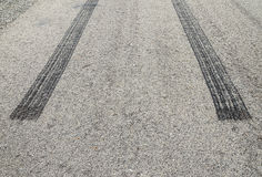 Burned rubber tire track on an asphalt road Stock Images