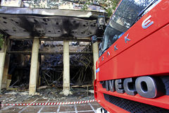 Burned store with a firefighters truck. In Athens Royalty Free Stock Images