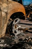 Burned to the ground car wreck. stock image