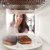Burned toasts and shocked girl Royalty Free Stock Image