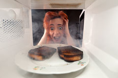 Burned toasts and shocked girl Stock Images