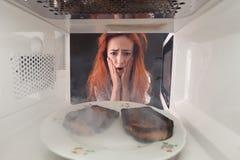 Burned toasts and shocked girl Stock Photo