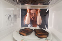 Burned toasts and shocked girl Stock Image