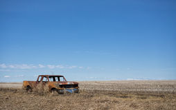 Burned truck along edge beside a field Stock Image