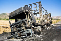 Burned truck in a roadside Stock Images