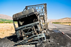 Burned truck waiting on road Stock Photo