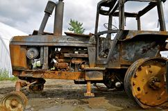 Burned up tractor Stock Photo