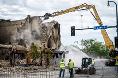 Free Burned Vandalized Building Collapsed To Wreckage After Looting In Minneapolis Riots For George Floyd In Black Lives Matter Protest Stock Photo - 185389730