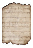 Burned Vintage Music Sheet. A vintage sheet of music, aged and burned around the edges Stock Images