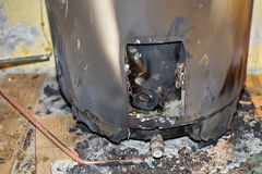 Burned Water Heater stock image