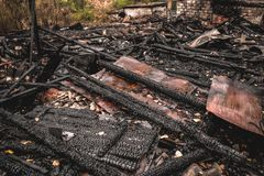 Burned wooden house in destroyed by fire district of city Stock Photos