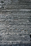 Burned wooden wall texture. Black Burned wooden wall texture Stock Images