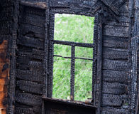 Burned wooden window frame Royalty Free Stock Photos