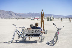Burner Couple Enjoying Art at Burning Man 2015 Stock Photography