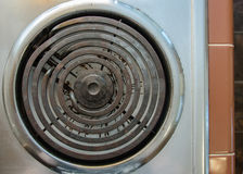 Burner of Electric Stove Top. Close-up of a spiral burner on an electric stove top from the 1950`s Stock Photo