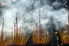 Burner incense sticks in a buddhist temple Stock Image