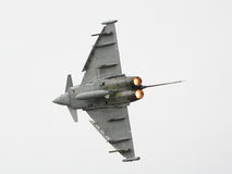 Burners. A Eurofighter banks right with its afterburners lit at an airshow in 2009 royalty free stock photography