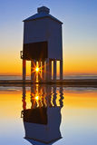 Burnham lighthouse at sunset. Burnham-on-sea nine leg low lighthouse at sunset stock image