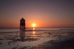 Burnham on Sea sunset. Sunset over the wooden lighthouse on Burnham on Sea beach in Somerset, UK Stock Photos