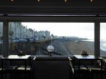Burnham seafront through the window of a cafe Stock Photos