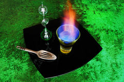 Burning absinthe. Still life with burning absinthe royalty free stock photo