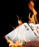 Burning aces in hand Stock Photo