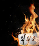 Burning aces in hand Stock Images