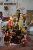 Burning Advent candle in Catholic church in Baidyapur, West Bengal, India Royalty Free Stock Photography