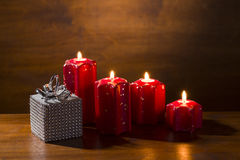 Burning advent candles with gift package Royalty Free Stock Image