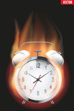 Burning alarm clock Stock Photography