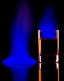 Burning alcohol. Close-up of burning alcohol on black background.Blue flame Royalty Free Stock Images