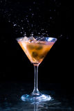 Burning alcoholic drink with ice cubes, isolated on black background Stock Photos