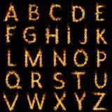 Burning alphabet. Fiery alphabet on black background Royalty Free Stock Photography