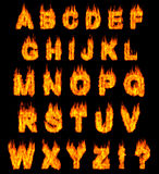 Burning Alphabet. Letters illustration isolated on black background Stock Photos