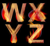 Burning alphabet letters, WXYZ. Burning WXYZ letters over dark,alphabet illustration Stock Photography