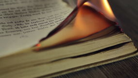 Burning antique book stock footage