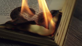 Burning antique book stock video footage