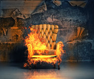 Burning armchair. In the grunge interior. 3D illustration creative concept Royalty Free Stock Images