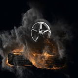 Burning auto wheels with smoke Stock Photo