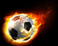 Burning ball. Fire destroys a fast moving ball Stock Photos