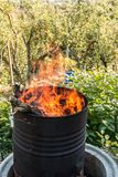 Burning barrel in the middle of the garden royalty free stock photography
