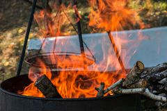Burning barrel in the middle of the garden royalty free stock photos