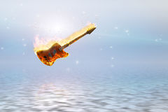 Burning bass guitar over clean pure ocean. High Resolution 3D Illustration Burning bass guitar over clean pure ocean Stock Image