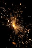 Burning Bengal fire on a black background. Christmas, New Year sparkle fire. Festive background, bengal light sparkler bright celebration holiday night party royalty free stock photography
