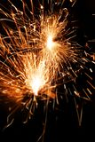 Burning Bengal fire on a black background. Christmas, New Year sparkle fire. Festive background, bengal light sparkler bright celebration holiday night party royalty free stock image
