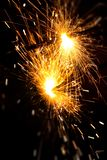 Burning Bengal fire on a black background. Christmas, New Year sparkle fire. Festive background, bengal light sparkler bright celebration holiday night party royalty free stock images